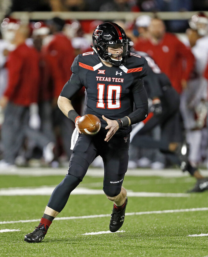 Texas Tech's Alan Bowman (10) runs with the ball during the first half of an NCAA college football game against Oklahoma, Saturday, Nov. 3, 2018, in Lubbock, Texas. (AP Photo/Brad Tollefson)