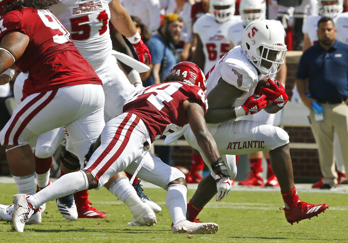 Florida Atlantic running back Devin Singletary (5) carries around Oklahoma defensive back Brendan Radley-Hiles (44) in the first half of an NCAA college football game in Norman, Okla., Saturday, Sept. 1, 2018. (AP Photo/Sue Ogrocki)