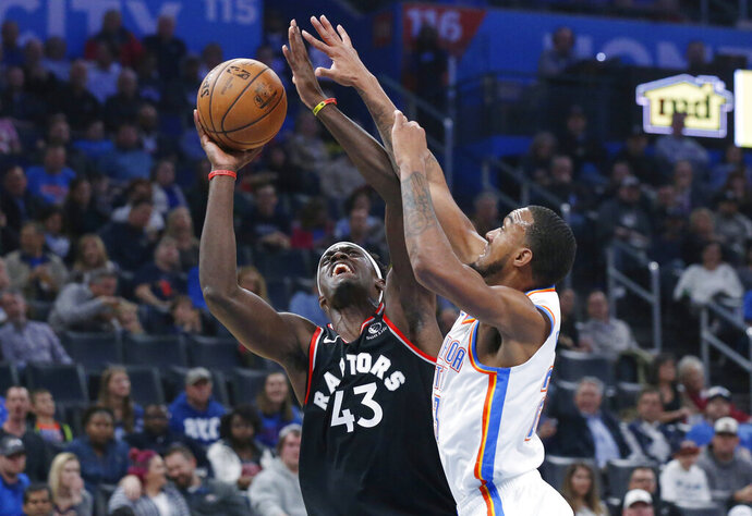 Toronto Raptors forward Pascal Siakam (43) shoots as Oklahoma City Thunder guard Terrance Ferguson defends during the first half of an NBA basketball game Wednesday, Jan. 15, 2020, in Oklahoma City. (AP Photo/Sue Ogrocki)