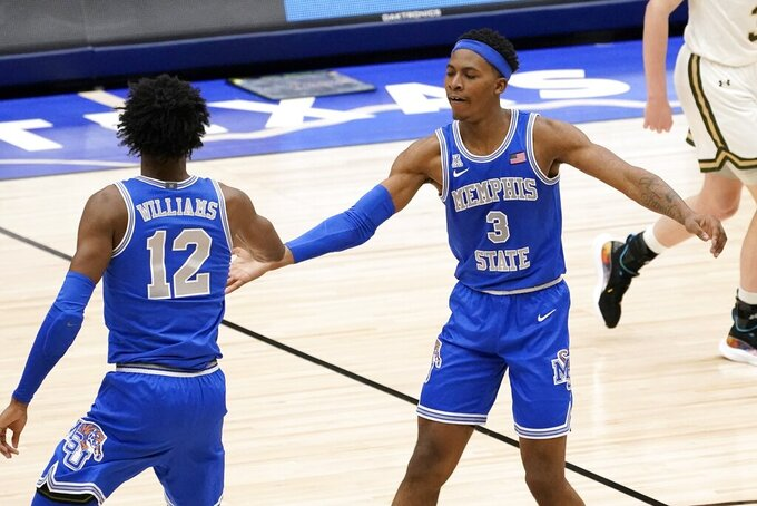 Memphis forward DeAndre Williams (12) and guard Landers Nolley II (3) celebrate a 3-point basket made by Nolley II in the second half of an NCAA college basketball game against Colorado State in the semifinals of the NIT, Saturday, March 27, 2021, in Frisco, Texas. (AP Photo/Tony Gutierrez)