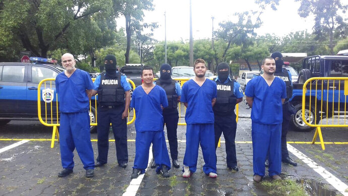 In this Oct. 17, 2018 photo, provided by the Nicaraguan National Police, prisoners detained and imprisoned during the recent uprisings against the government of President Daniel Ortega, are shown to the press in Managua, Nicaragua. At left is Eddy Antonio Montes Praslin, who was killed on Thursday, May 16, 2019, by a bullet in a prison north of the capital amid disturbances that left six prison officials injured, Nicaragua's interior ministry said. (Nicaraguan National Police via AP)