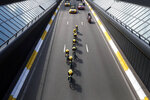 Team Jumbo Visma strains during the second stage of the Tour de France cycling race, a team time trial over 27.6 kilometers (17 miles) with start and finish in Brussels, Belgium, Sunday, July 7, 2019. (AP Photo/Christophe Ena)