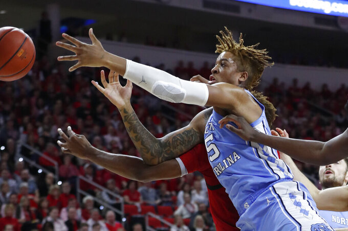 North Carolina's Armando Bacot (5) goes after a rebound with North Carolina State's Manny Bates (15) during the first half of an NCAA college basketball game at PNC Arena in Raleigh, N.C., Monday, Jan. 27, 2020. (Ethan Hyman/The News & Observer via AP)