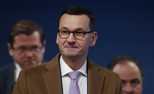 Polish Prime Minister Mateusz Morawiecki arrives for an EU summit in Brussels, Friday, Dec. 13, 2019. European Union leaders are gathering Friday to discuss Britain's departure from the bloc amid some relief that Prime Minister Boris Johnson has secured an election majority that should allow him to push the Brexit deal through parliament. (Christian Hartmann, Pool Photo via AP)