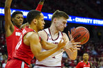 Ohio State's CJ Walker (13) fouls Wisconsin's Tyler Wahl, right, during the second half of an NCAA college basketball game Sunday, Feb. 9, 2020, in Madison, Wis. (AP Photo/Andy Manis)