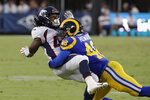 FILE - Los Angeles Rams linebacker Travin Howard (48) makes a tackle during an NFL preseason football game against the Denver Broncos, Saturday, Aug. 24, 2019, in Los Angeles. Travin Howard will miss the upcoming season after tearing the meniscus in his knee, depriving the Los Angeles Rams of a probable starter at inside linebacker. Rams coach Sean McVay announced Tuesday, Sept. 1, 2020, that Howard will need surgery. (AP Photo/Rick Scuteri, File)
