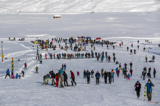 "Indian tourists and locals ski on a slope in Gulmarg, northwest of Srinagar, Indian controlled Kashmir, Monday, Jan. 11, 2021. Snow this winter has brought along with it thousands of locals and tourists to Indian-controlled Kashmir's high plateau, pastoral Gulmarg, which translates as ""meadow of flowers."