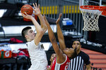 Purdue center Zach Edey (15) shoots over Ohio State forward Zed Key (23) in the first half of an NCAA college basketball game at the Big Ten Conference tournament in Indianapolis, Friday, March 12, 2021. (AP Photo/Michael Conroy)