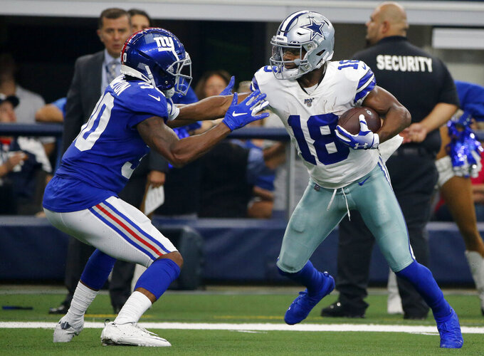 New York Giants cornerback Antonio Hamilton (30) attempts to stop Dallas Cowboys wide receiver Randall Cobb (18) after Cobb caught a pass in the first half of a NFL football game in Arlington, Texas, Sunday, Sept. 8, 2019. (AP Photo/Michael Ainsworth)