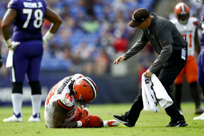 Cleveland Browns defensive tackle Sheldon Richardson (98) reacts as a trainer rushes in to help him after a play against the Baltimore Ravens during the second half of an NFL football game Sunday, Sept. 29, 2019, in Baltimore. (AP Photo/Gail Burton)