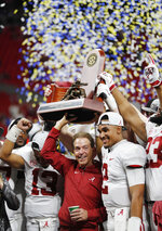 FILE - In this Saturday, Dec. 1, 2018 file photo, Alabama head coach Nick Saban and Alabama quarterback Jalen Hurts, right, celebrate with the team after the Southeastern Conference championship NCAA college football game against Georgia, in Atlanta. Alabama won 35-28. Even before Hurts came off the bench to lead Alabama's comeback win over Georgia in the Southeastern Conference championship game, his popularity has only seemed to grow since his role shrank. (AP Photo/John Bazemore, File)