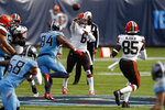 Cleveland Browns quarterback Baker Mayfield (6) passes to tight end David Njoku (85) as Mayfield is pressured by Tennessee Titans defensive tackle Jack Crawford (94) in the first half of an NFL football game Sunday, Dec. 6, 2020, in Nashville, Tenn. (AP Photo/Wade Payne)