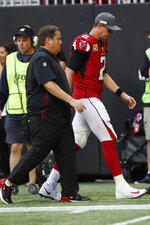 Atlanta Falcons quarterback Matt Ryan (2) leaves the field after injury against the Los Angeles Rams during the second half of an NFL football game, Sunday, Oct. 20, 2019, in Atlanta. (AP Photo/John Bazemore)