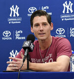 New York Yankees pitcher Danny Farquhar speaks to reporters during baseball spring training Friday, Feb. 15, 2019, in Tampa, Fla. Farquhar is pitching with the Yankees after undergoing brain surgery for a ruptured aneurysm and must wear a special protective cap. (Thomas A. Ferrara/Newsday via AP)
