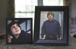 In this Friday, Sept. 13, 2019, photo, Denise Spence shows photos of her son Timothy at her home in Elk Grove Village, Ill. Spence said Timothy died of an opioid overdose. While the nation's attorneys general debate a legal settlement with Purdue Pharma, the opioid epidemic associated with the company's blockbuster painkiller OxyContin rages on. (AP Photo/Teresa Crawfor)