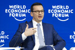 Poland's Prime Minister Mateusz Morawiecki attends a session of the annual meeting of the World Economic Forum in Davos, Switzerland, Thursday, Jan. 24, 2019. (Gian Ehrenzeller/Keystone via AP)