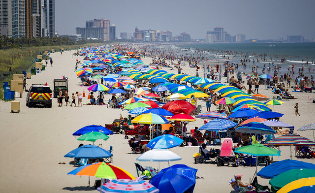 People fill the beach in North Myrtle Beach, S.C., Saturday, July 4 as coronavirus cases continue to surge. At least 41,413 people in South Carolina have tested positive for the coronavirus, and 787 have died, according to state health officials. (Josh Bell/The Sun News via AP)