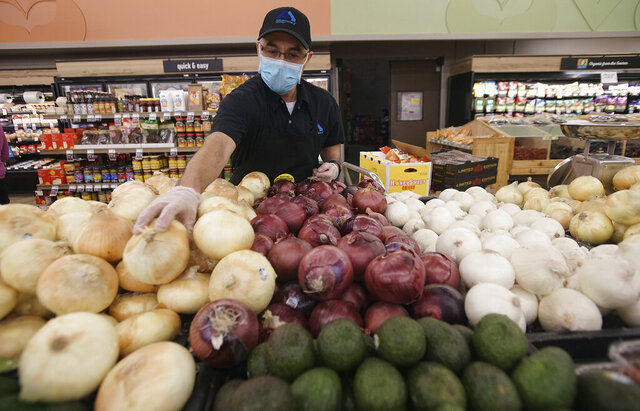 Albertson's Grocery store Produce Manager Jake Sandoval stocks onions at the store located in the South Valley of Albuquerque, New Mexico. Grocery stores are adjusting in the midst of the Covid- 19 outbreak. Photographed on Wednesday April 8, 2020.(Adolphe Pierre-Louis/The Albuquerque Journal via AP)