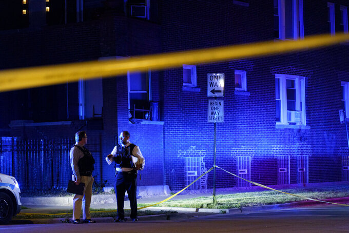 Police work the scene of a shooting in the East Garfield Park neighborhood on Tuesday June 15, 2021 in Chicago. Police say five people standing outside on Chicago's West Side were shot in a violent end to a day that began with a fatal mass shooting on the city's South Side (Armando L. Sanchez/Chicago Tribune via AP)