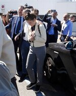 Amanda Knox is approached by a journalist upon her arrival in Linate airport, Milan, Italy, Thursday, June 13, 2019. Knox has returned to Italy for the first time since she was convicted and imprisoned, but ultimately acquitted, for the murder and sexual assault of her British roommate Meredith Kercher in the university town of Perugia in 2007. Knox is in Italy to attend a conference in Modena organized by the Italy Innocence Project, which seeks to help people who have been convicted for crimes they did not commit. (AP Photo/Antonio Calanni)