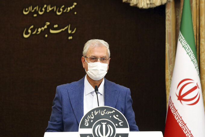 In this photo released by the official website of the office of the Iranian Presidency, cabinet spokesman Ali Rabiei speaks at his weekly press briefing in Tehran, Iran, Tuesday, July 6, 2021. Rabiei on Tuesday accused Israel of a sabotage attack in June that reportedly targeted a civilian nuclear facility near Tehran, the official IRNA news agency reported. (Iranian Presidency Office via AP)