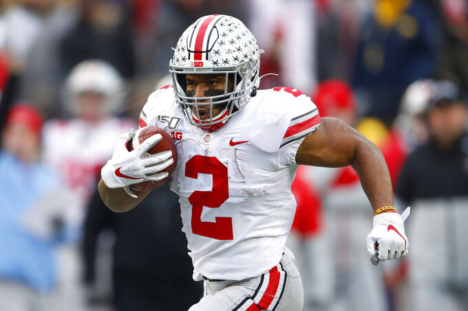 FILE - In this Nov. 30, 2019, file photo, Ohio State running back J.K. Dobbins runs for a 33-yard touchdown against Michigan in the second half of an NCAA college football game in Ann Arbor, Mich. Dobbins was selected by the Baltimore Ravens in the second round of the NFL football draft Friday, April 24, 2020. (AP Photo/Paul Sancya, File)