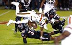 North Carolina State linebacker Vi Jones (31) sacks Miami quarterback D'Eriq King (1) during the first half of an NCAA college football game Friday, Nov. 6, 2020, in Raleigh, N.C. (Ethan Hyman/The News & Observer via AP, Pool)