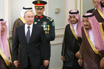 Russian President Vladimir Putin, center left, and Saudi Arabia's King Salman, right, attend the official welcome ceremony in Riyadh, Saudi Arabia, Monday, Oct. 14, 2019. Putin traveled to Saudi Arabia on Monday, meeting with the oil-rich nation's king and crown prince as he seeks to cement Moscow's political and energy ties across the Mideast. (AP Photo/Alexander Zemlianichenko, Pool)