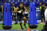 Wisconsin running back Jonathan Taylor runs a drill at the NFL football scouting combine in Indianapolis, Friday, Feb. 28, 2020. (AP Photo/Michael Conroy)