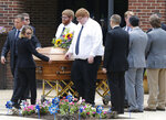FILE - In this Thursday, June 6, 2019 file photo, the casket of Virginia Beach shooting victim Katherine Nixon is brought to a hearse after a funeral service at St. Gregory The Great Catholic Church in Virginia Beach, Va. Police in Virginia Beach cannot determine the motivation behind a city engineer's rampage in 2019 that killed 12 people in the municipal building where he worked, according to the city's final investigative report that was released Wednesday, March 24, 2021. (AP Photo/Steve Helber)