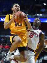 Arizona State's Jaelen House goes up for a basket as St. John's Rasheem Dunn, right, defends during the first half of an NCAA college basketball game, Saturday, Nov. 23, 2019, in Uncasville, Conn. (AP Photo/Jessica Hill)
