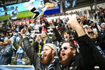 In this April 13, 2019, photo, Minnesota United supporters Eric Stevens, left, from Mississippi, and Dan Vitale, of Seattle, cheered as their team took the field for warmups before an MLS soccer match in St. Paul, Minn. The first season for Minnesota United at Allianz Field has been a sold-out success. As the Loons prepare for their first MLS playoff game, they'll have their raucous supporters section behind them to help. (Aaron Lavinsky/Star Tribune via AP)