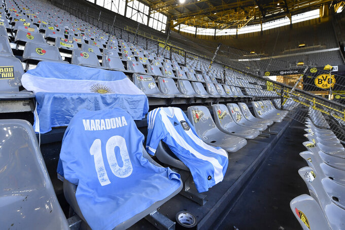 Diego Maradona jersey is displayed on the stands ahead of the German Bundesliga soccer match between Borussia Dortmund and 1.FC Cologne in Dortmund, Germany, Saturday, Nov. 28, 2020. (AP Photo/Martin Meissner, Pool)