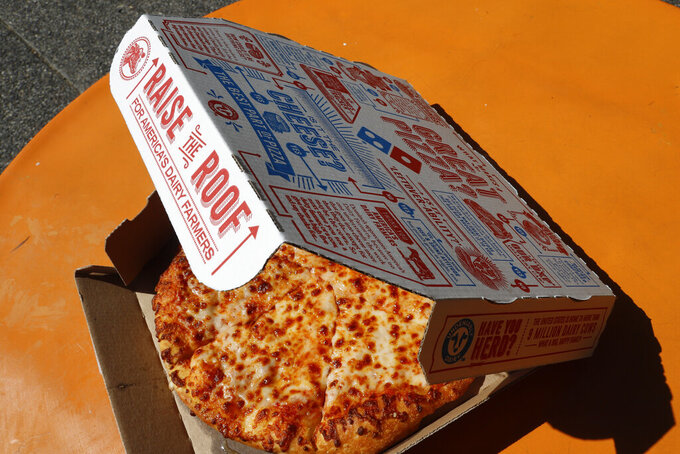 FILE - This July 15, 2019, file photo shows a small Domino's pizza made in a Domino's Pizza shop in downtown Pittsburgh.  After a pandemic-fueled boom, U.S. pizza sales appear to be headed back to Earth. Domino's and Papa John's pizza chains both said Thursday, Feb. 25, 2021,  that their same-store sales lost steam in the fourth quarter compared to the huge increases they saw earlier in 2020.    (AP Photo/Gene J. Puskar, File)