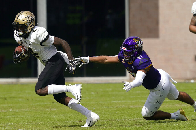 Central Florida wide receiver Ryan O'Keefe (4) runs the ball as East Carolina defensive back Warren Saba (17) chases during the first half of an NCAA college football game in Greenville, N.C., Saturday, Sept. 26, 2020. (AP Photo/Gerry Broome)