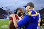 Arizona Cardinals wide receiver Larry Fitzgerald, left, greets Los Angeles Rams quarterback Jared Goff after an NFL football game Sunday, Dec. 29, 2019, in Los Angeles. (AP Photo/Mark J. Terrill)