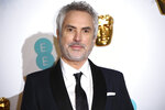 Director Alfonso Cuaron poses for photographers upon arrival at the BAFTA awards in London, Sunday, Feb. 10, 2019. (Photo by Joel C Ryan/Invision/AP)
