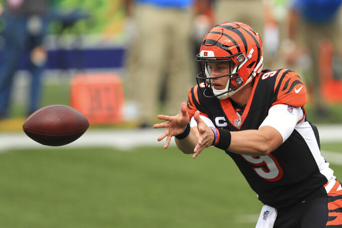 Cincinnati Bengals quarterback Joe Burrow (9) tosses the football during the first half of an NFL football game against the Los Angeles Chargers, Sunday, Sept. 13, 2020, in Cincinnati. (AP Photo/Aaron Doster)