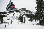 Skiers ride a chairlift at Alpine Meadows Ski Resort on Friday, Jan. 17, 2020, in front of the mountain traversed by the Subway Cirque ski run where one person was killed and another seriously injured in an avalanche earlier in the day. (Jason Pierce/The Sacramento Bee via AP)