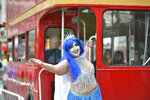 A reveller poses for a photo during the Pride in London Parade in central London, Saturday, July 6, 2019. (Dominic Lipinksi/PA via AP)