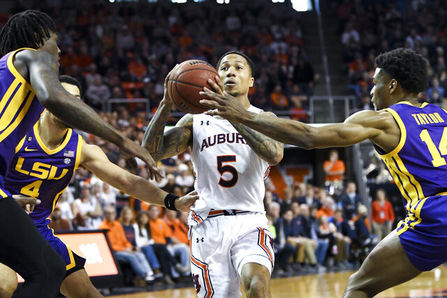 Auburn guard J'Von McCormick (5) drives past LSU guard Marlon Taylor (14) during the second half of an NCAA college basketball game Saturday, Feb. 8, 2020, in Auburn, Ala. (AP Photo/Julie Bennett)