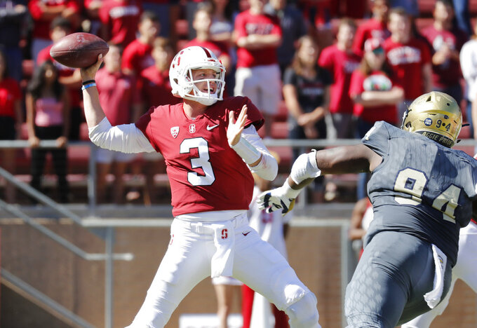 Stanford quarterback K.J. Costello (3) throws an interception against UC Davis in the first half in an NCAA college football game in Stanford, Calif., Saturday, Sept. 15, 2018. (AP Photo/Jim Gensheimer)