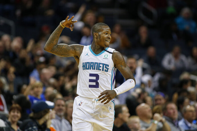 Charlotte Hornets guard Terry Rozier reacts after hitting a 3-pointer against the Toronto Raptors during the second half of an NBA basketball game in Charlotte, N.C., Wednesday, Jan. 8, 2020. Toronto won 112-110 in overtime. (AP Photo/Nell Redmond)