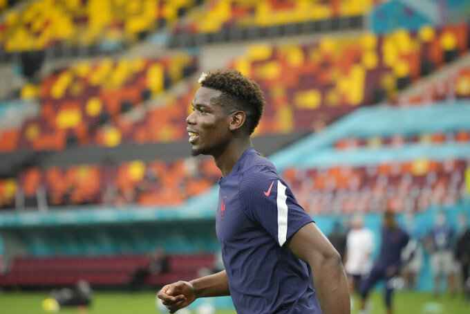 France's Paul Pogba warms up during a training session at the National Arena stadium in Bucharest, Romania, Sunday, June 27, 2021, the day before their round of 16 match against Switzerland. (AP Photo/Vadim Ghirda)