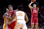 Wisconsin guard Kobe King (23) shoots the ball over Tennessee guard Josiah-Jordan James (5), Wisconsin forward Nate Reuvers (35) and Tennessee guard/forward Yves Pons (35) during an NCAA college basketball game, Saturday, Dec. 28, 2019 in Knoxville, Tenn. on Saturday, Dec. 28, 2019. (Calvin Mattheis/Knoxville News Sentinel via AP)