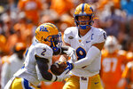 Pittsburgh quarterback Kenny Pickett (8) hands the ball off to running back Israel Abanikanda (2) during the first half of an NCAA college football game against Tennessee, Saturday, Sept. 11, 2021, in Knoxville, Tenn. (AP Photo/Wade Payne)