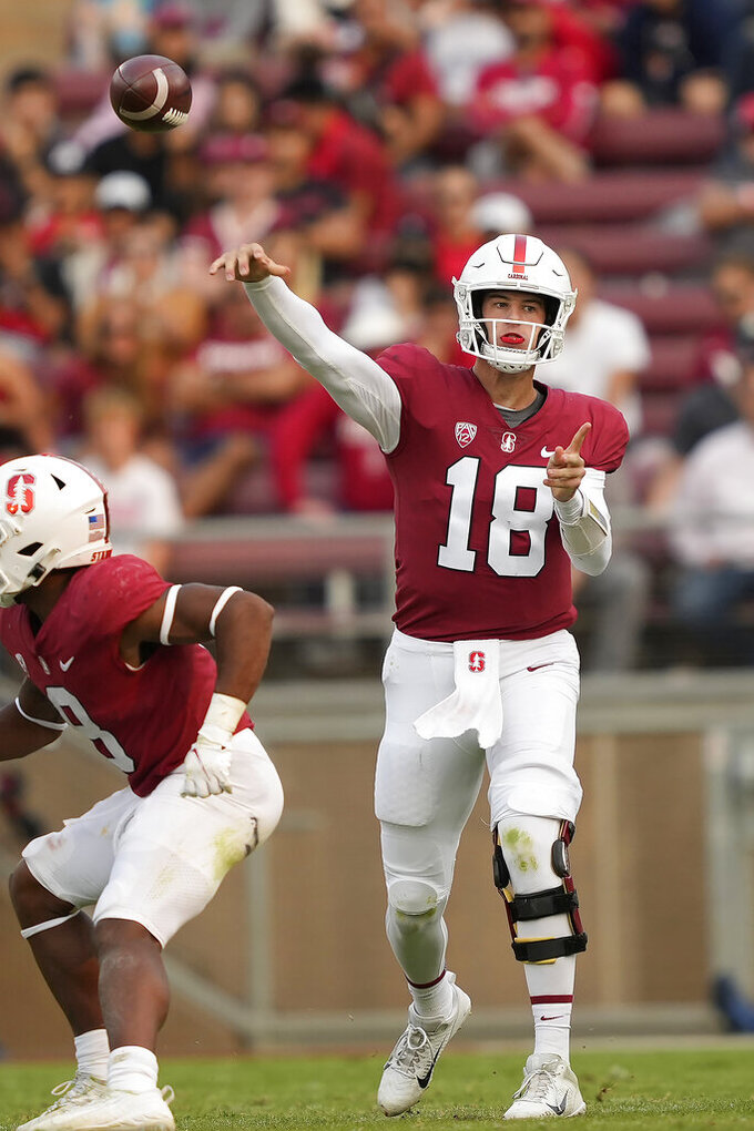Stanford quarterback Tanner McKee (18) throws a touchdown pass against the UCLA during the second half of an NCAA college football game Saturday, Sept. 25, 2021, in Stanford, Calif. (AP Photo/Tony Avelar)