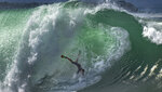 A bodysurfer is churned around in a wave at the Wedge in Newport Beach, Calif., Saturday, July 4, 2020. (Mindy Schauer/The Orange County Register via AP)