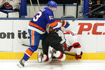 New York Islanders' Casey Cizikas (53) checks New Jersey Devils' Yegor Sharangovich (17) during the second period of an NHL hockey game Saturday, May 8, 2021, in Uniondale, N.Y. Cizikas was penalized for boarding. (AP Photo/Frank Franklin II)