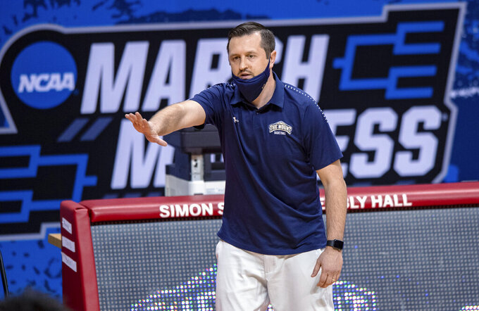 Mount St. Mary's coach Dan Engelstad reacts to the action on the court during the first half of a First Four game against Texas Southern in the NCAA men's college basketball tournament Thursday, March 18, 2021, in Bloomington, Ind. (AP Photo/Doug McSchooler)